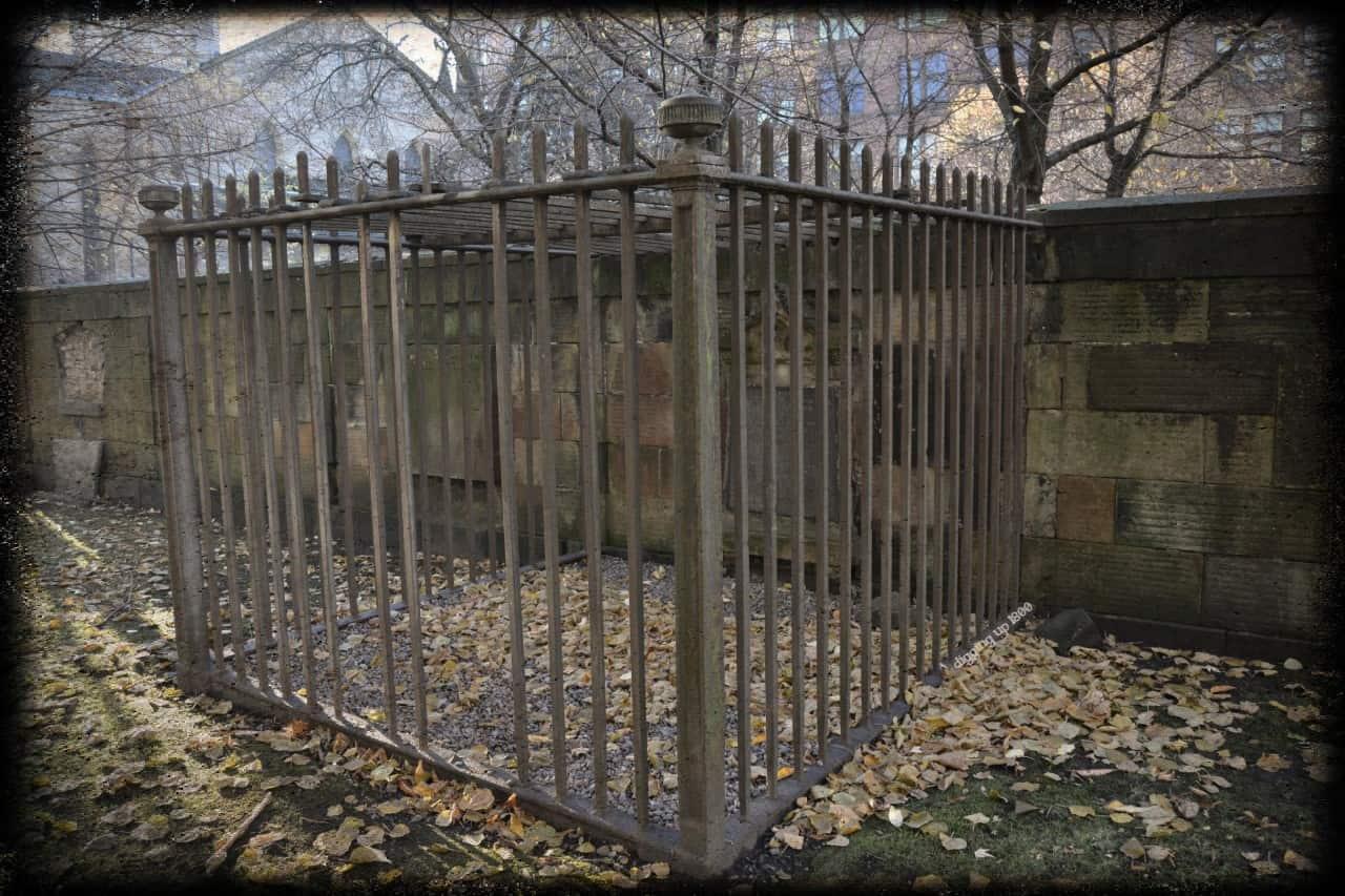 A caged lair in Ramshorn Kirkyard, Ingram St, Glasgow, Scotland