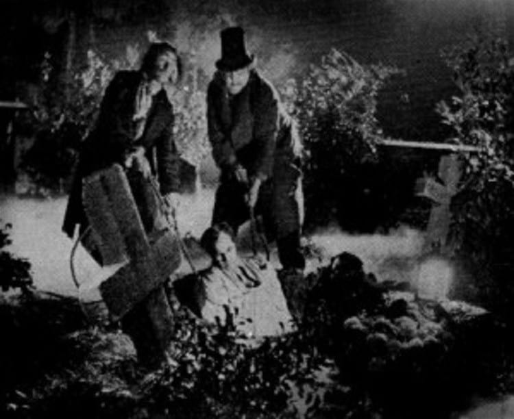 Grave robeers or body snatchers stealing a cadaver from a grave