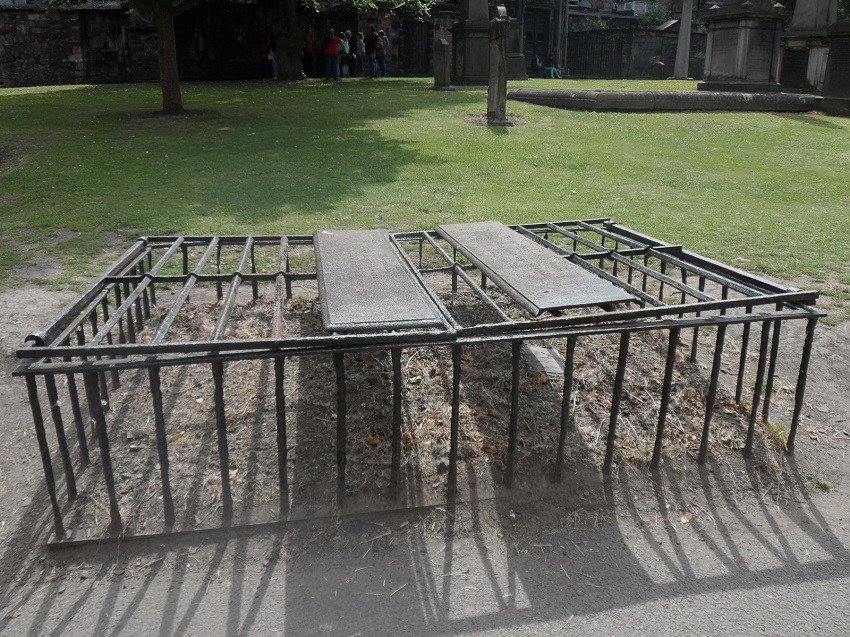 One of the iron mortsafes at Greyfriars Kirkyard Edinburgh Scotland